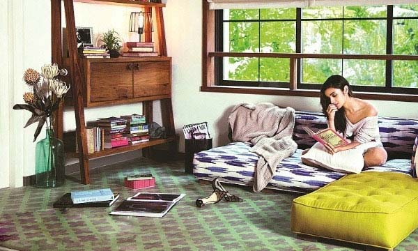 A still of Alia Bhatt enjoying a book at her new residence.